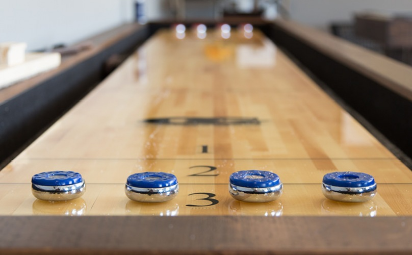 close up of shuffleboard table in game room